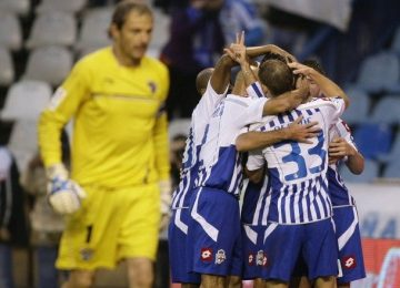 deportivo-corunas-players-celebrate-their-goal-against-malaga-during-their-spanish-first-division-soccer-match-at-riazor-stadium-in-coruna
